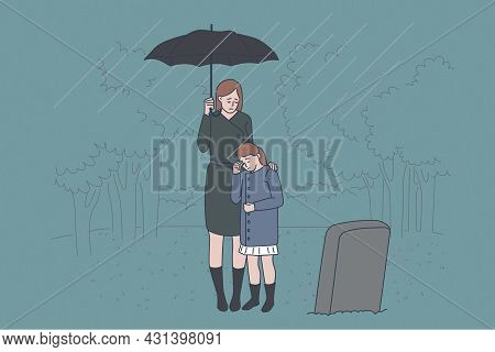 Family Grief And Loss Concept. Sad Crying Mother And Daughter Standing On Cemetery Near Fathers Grav