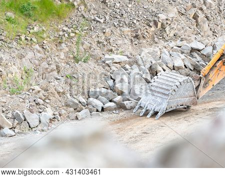 Detail Of An Excavator Bucket. Backhoe Bucket Digging The Soil. Crawler Excavator Digging At Shale L