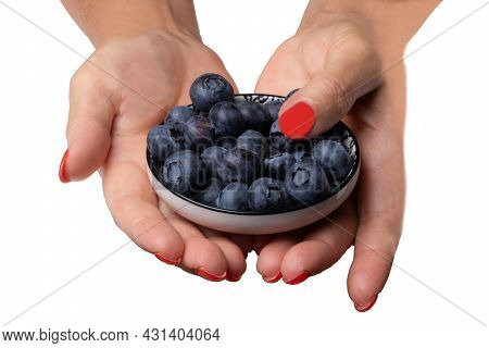 Female Hands Holding A Ceramic Bowl Full Of Blueberries Isolated On A White Background. Health Conce