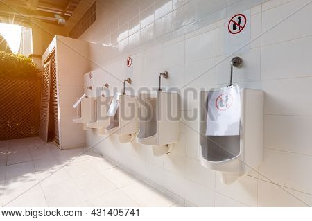 Social Distance In Washroom Urinal. Covid 19 Poster For Washroom And Toilet. People Are Maintain Soc