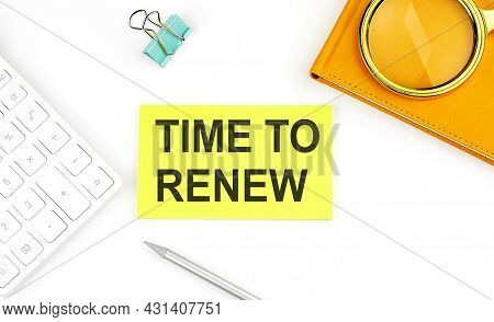 Sticker With The Text Time To Renew On White Background, Near Calculator And Notebook