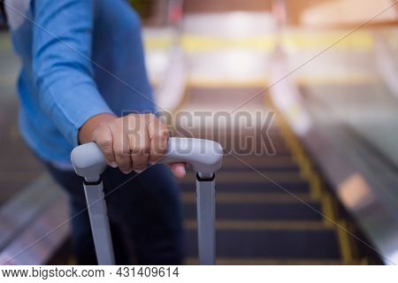 Traveler Woman Hold Luggage On Escalator At Terminal Airport Or Transit Flight With Suitcase In Jour