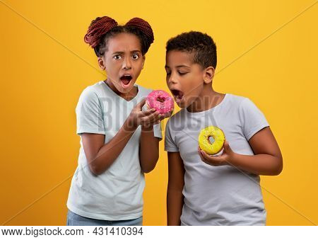 Sweet-tooth Black Guy Biting His Sisters Donut