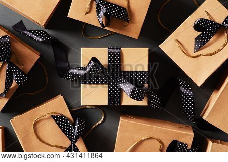 Black Friday Concept With Craft Package With Black Bow And Ribbon, Top View, Copy Space, Flat Lay