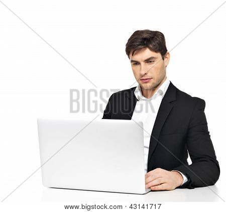 Office Worker With  Laptop Sitting On The Table