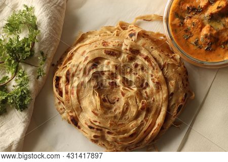 Parotta Or Porotta, A Layered Flatbread Made Of Maida. This Flaky Ribbon Pancake Is A Favourite Of K