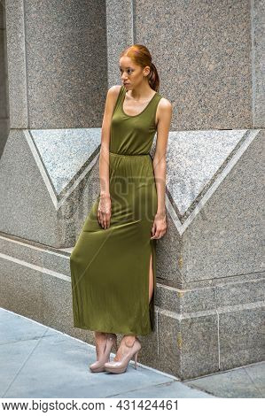 Woman Relaxing Outside. Dressing In A Green Maxi Tank Dress, High Heels,   A Young Black Lady Is Sta