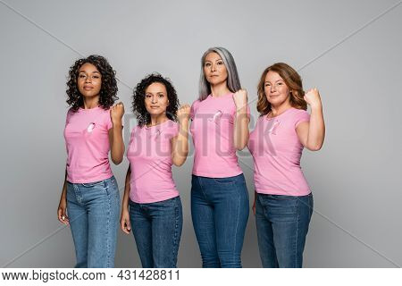 Interracial Women With Ribbons Of Breast Cancer Awareness Showing Yes Gesture Isolated On Grey