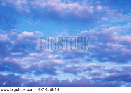 Cloudy Skies In Blue And Pink. Heavenly Background.