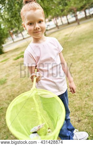 Little Girl Playing With Butterfly Net. Summer Adventure. Happy Toddler. Catch Bug Scoop. Lifestyle