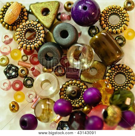An assortment of beads in different shapes, colours and sizes for embellishment and art poster