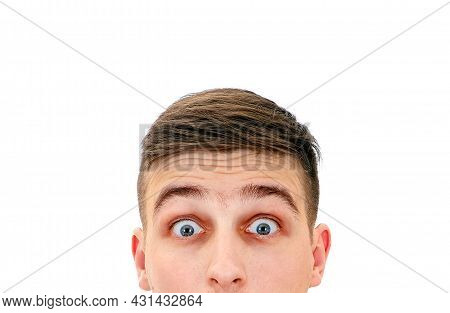 Surprised Young Man Face Closeup On The White Background