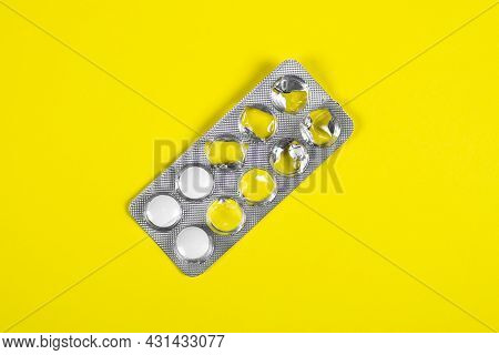 Pills Pack On The Yellow Paper Background Closeup