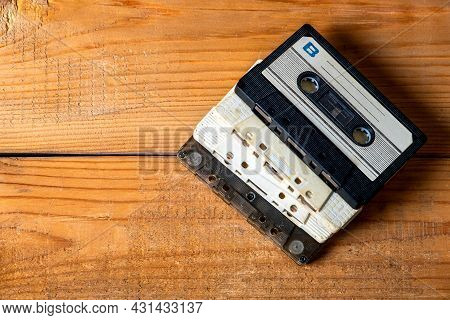 Old Audio Cassettes On A Wooden Planks Background Closeup
