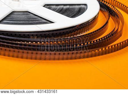 Old Film Reel On The Orange Background Closeup