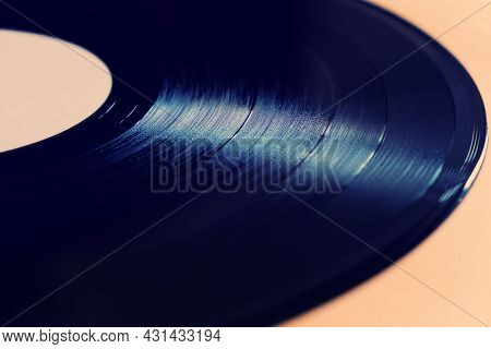 Toned Photo Of Old Vinyl Record On The Table Closeup