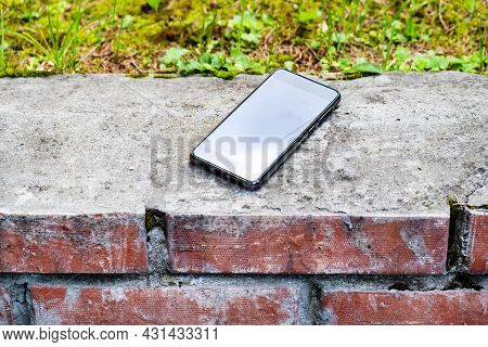Lost Mobile Phone On The Sidewalk On The Street