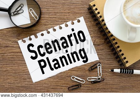 Scenario Planning, Text On Wood Table, On White Paper