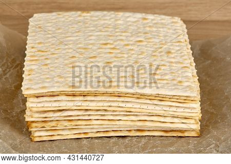 A Lot Of Traditional Jewish Matzoh Lies On Paper.