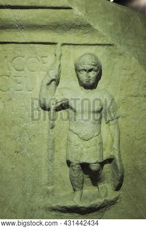 Lisbon, Portugal- May 24, 2018: Beautiful Small Stone Statue In A Carved Tombstone Exhibited In The