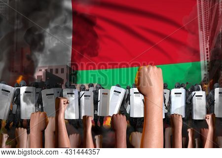 Riot Fighting Concept - Protest In Madagascar On Flag Background, Police Swat Stand Against The Demo