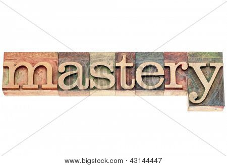 mastery  - isolated word in vintage letterpress wood type printing blocks