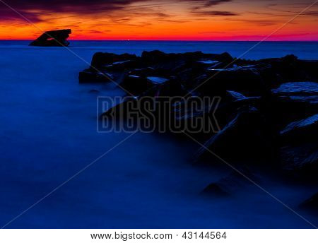 The U.S.S. Atlantus shipwreck and a jetty at sunset, seen from Sunset Beach, Cape May, New Jersey.