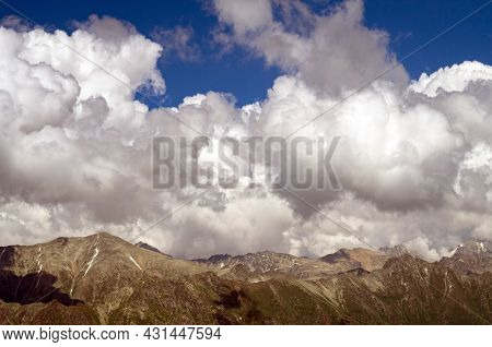 Beautiful Mountain Landscape Of The Caucasus Mountain Range. Mountain Peaks And Clouds.