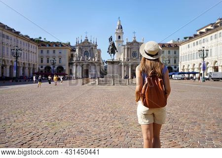 Tourism In Turin, Italy. Back View Of Traveler Girl Walking In San Carlo Square Enjoying Cityscape O