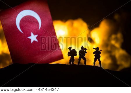 Turkey Small Flag On Burning Dark Background. Concept Of Crisis Of War And Political Conflicts Betwe
