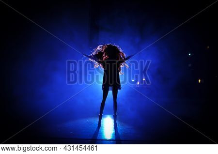 Silhouette Of A Female Face On A Light Background. Silhouette Of A Lonely Doll With Long Hair At Nig