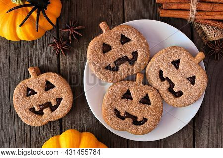 Plate Of Halloween Jack O Lantern Cookies. Chocolate And Pumpkin Spice. Top View With Decor On A Dar