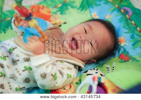 Baby on a play mat