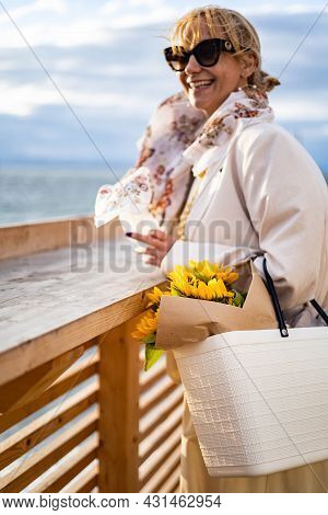 Fashionable Relaxed Woman Contemplating Wavy Sea From Embankment Enjoying Freedom Freshness