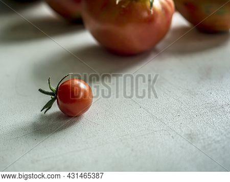 Red Small Cherry Tomato On The Windowsill