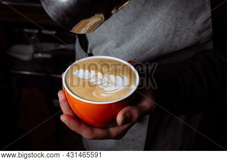 Latte Coffee, Barista Pouring Milk In To Coffee, Making Coffee With Latte Art