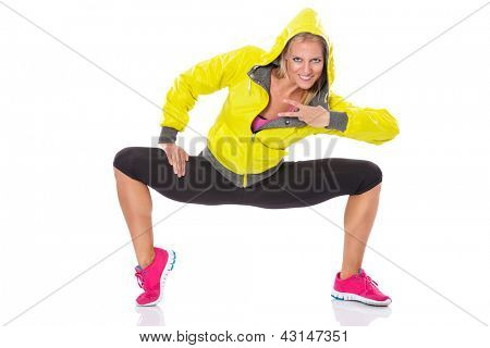 Sporty attractive woman dancing, isolated on white background