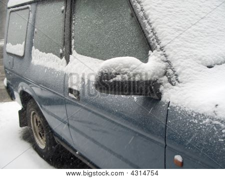 Suv Covered In Snow