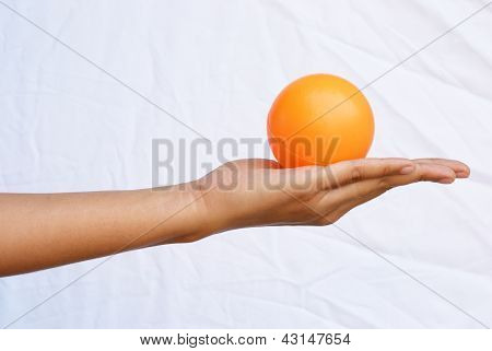 Put The Orange Ball On To Your Hand