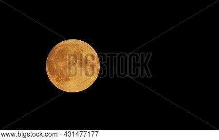 Full Orange Moon movement across the sky on July 23, 2021. Halloween Moon concept.