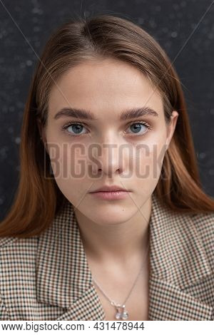 Closeup Portrait Of Young Attractive Caucasian Woman With Long Hair, Blue Eyes In Suit Jacket. Skinn