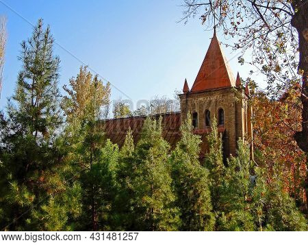 Evangelical Lutheran Church Surrounded By Park Trees, Quite Exotic Building For Tashkent. In Soviet