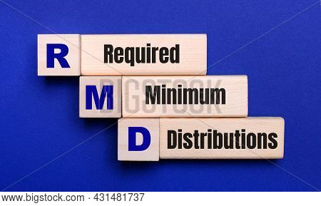 On A Bright Blue Background, Light Wooden Blocks And Cubes With The Text Rmd Required Minimum Distri