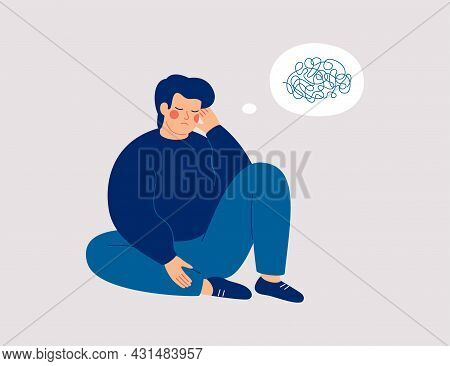 Sad Man Sits On The Floor With Tangled Thoughts. The Unhappy Boy Has Confused Thinking. The Depresse