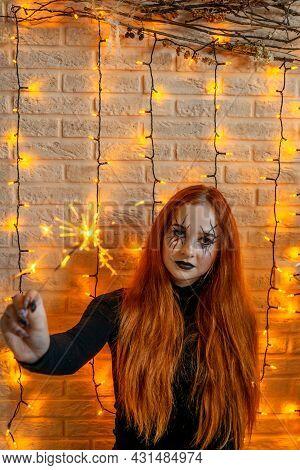 Halloween Witch With Sparkler, Garland On Background.