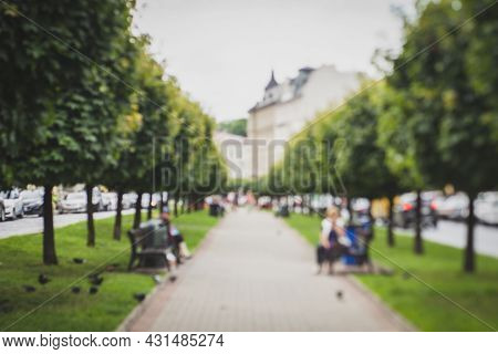 Natural Bokeh Of Blurry View Of A Park Or Alley, Blurred Out Of Focus Background. Abstract Beautiful