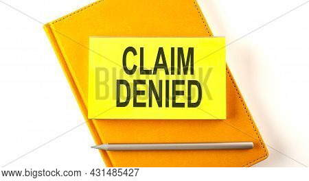 Text Claim Denied On The Sticker On Yellow Notebook