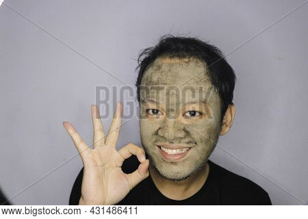 Smile Asian Man Was Happy At The Camera When He Use Beauty Face Mask