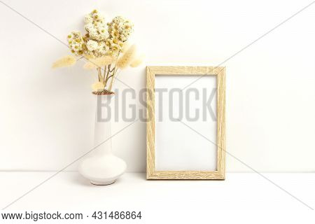Mockup Photo Frame And Vase With Dried Flowers. Empty Photo Frame Mockup To Showcase Your Art And Ph