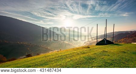 Rural Landscape At Sunrise. Beautiful Autumnal Mountain Scenery. Green Grassy Meadow On The Hillside